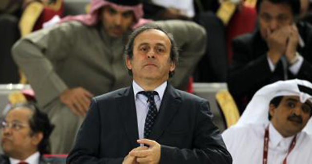 Michel Platini em 2011, no Catar. (AFP PHOTO / KARIM JAAFAR)