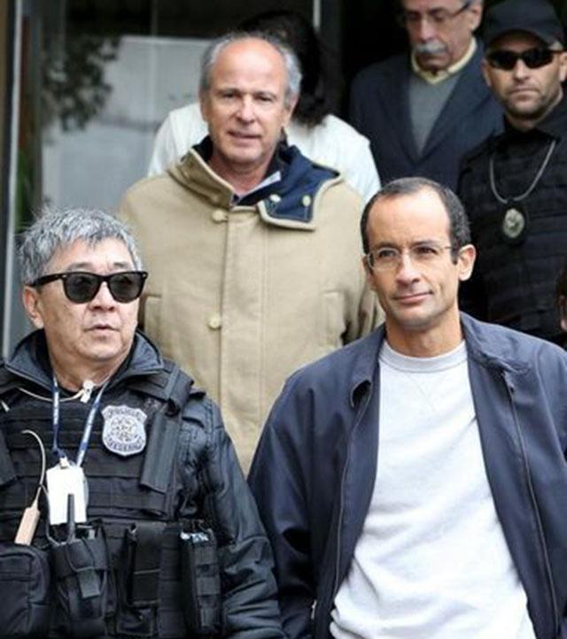 CORREÇÃO-Ex-CEOs de Odebrecht e OAS discutem entre si delação premiada, diz o Globo